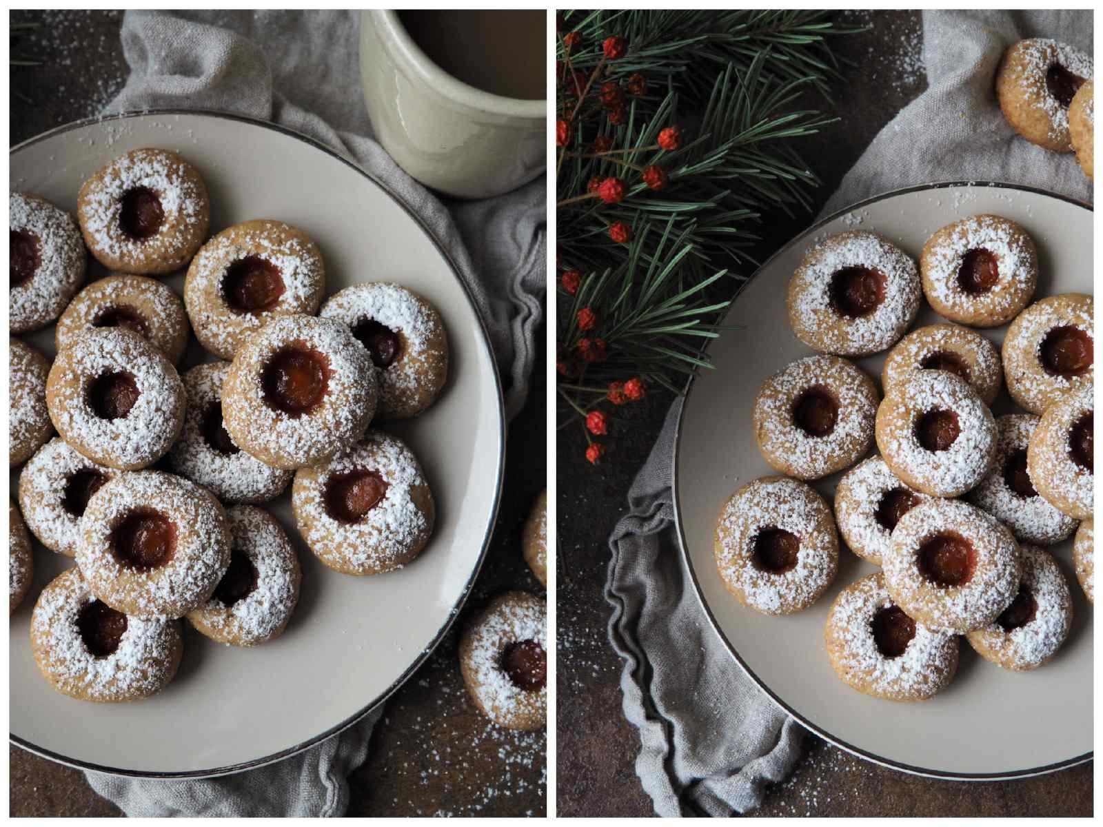 Vegane Engelsaugen - Schnelle und einfache Plätzchen: Mürbeteig gefüllt mit Konfitüre auf Teller